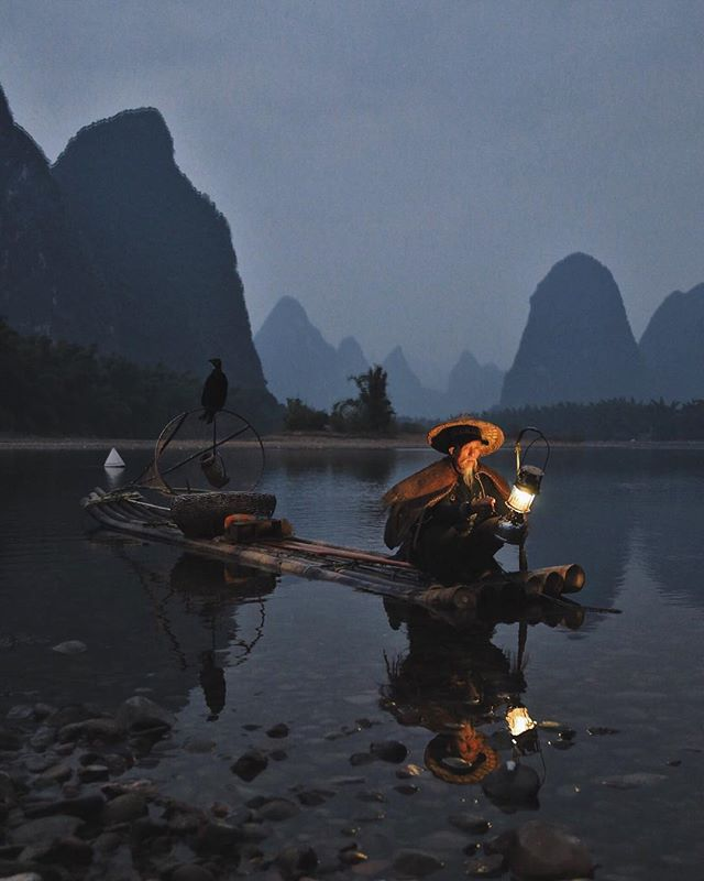 Someday, I'll actually edit all my photos from China. But this will still probably be my favorite one. One of the few remaining cormorant fishermen (it's a dying practice and skill) lights his lantern, his cormorant alert at the raft's highest point in the waning light.