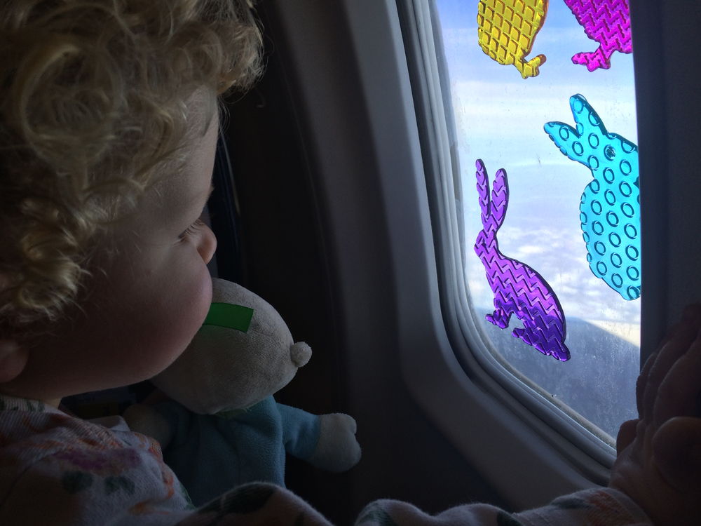 Flying with a 2-year-old: bring along window clings for easy entertainment!