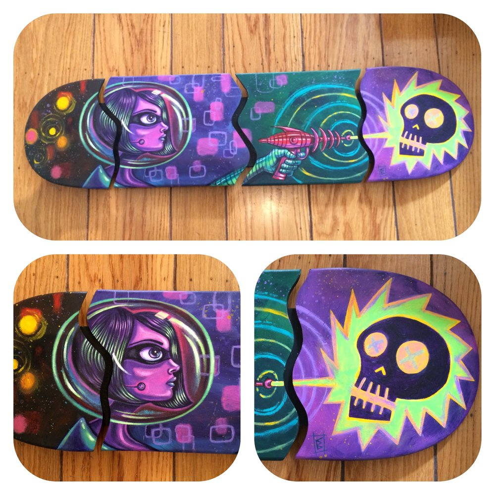 """Against The Grain"" is a fun group show at El Cuervo Gallery in El Segundo CA. The show features art on skate decks or with a skateboard theme. The art reception is Saturday, February 18th 2017. This piece is titled ""Death Ray"" and is acrylic on jig sawed skate deck."
