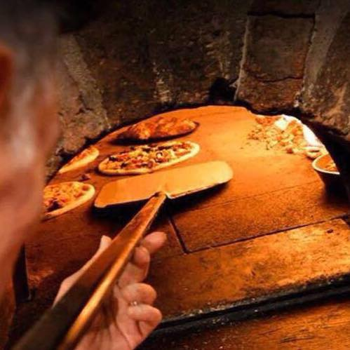 Wood fire pizza oven. Photo courtesy of Godfather Pizzeria.