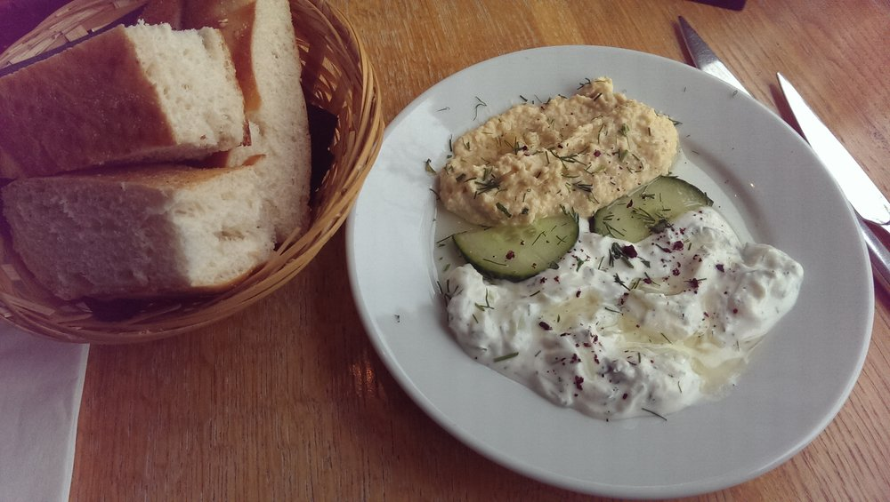 Homemade bread and dips; tzatziki with olive oil and hummus  (complementary)