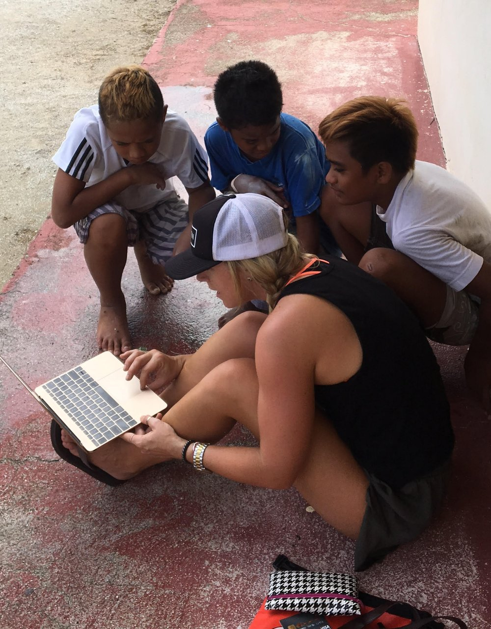 In some of the remote islands of French Polynesia, the only place to get wifi is on the stoop of the local post office. My new friends and I sang some Edward Sharpe and checked out my photos from New Zealand despite the language barrier.