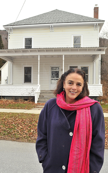 ELIZABETH READY, DIRECTOR of the John Graham Emergency Shelter in Vergennes, stands in front of a multi-family Bristol home the agency has acquired to use as transitional housing for people moving out of the shelter. Independent photo/Trent CampbelL