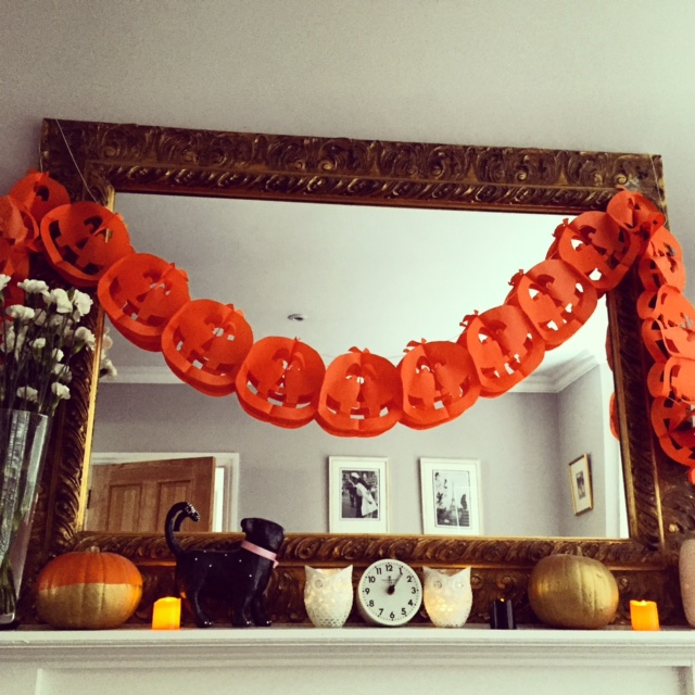 It's not a party without some bunting. If you have a mantelpiece, use it to display  spray-gold pumpkins  and flameless candles. If you have a black cat, add it here too as a subtle salute to the character Thackery Binx...