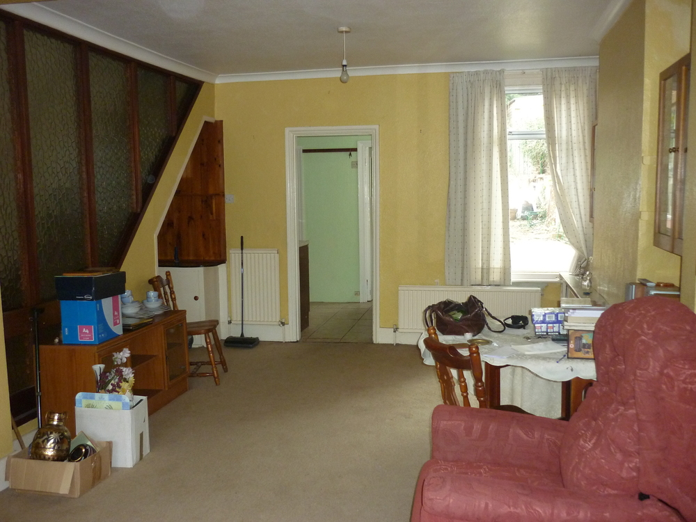 Before: Mustard woodchip wallpaper, odd radiators and a questionable glass-panelled staircase.