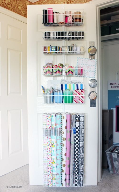 Door rack.    (Photo: iHeart Organizing)      (Product: Elfa wall rack system)