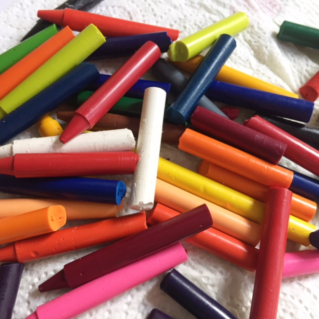Snap crayons in half as you don't need a whole crayon for melting.
