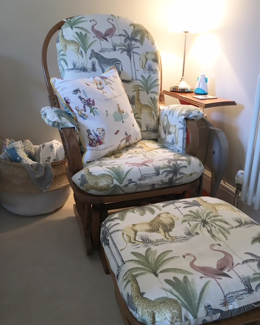 Nursing chair / zone: This was my Auntie's chair which I had recovered with a print both my Sister S and I liked (S loves giraffes and I love flamingos). The covers are removable so washing is easy. I also added an elephant table made by my Grandad to keep a light on for night time feeds, plus a place to put drinks etc. A belly basket also provides some storage for muslins and blankets. I also added an extra cushion for comfort - a Roald Dahl Willy Wonka one!