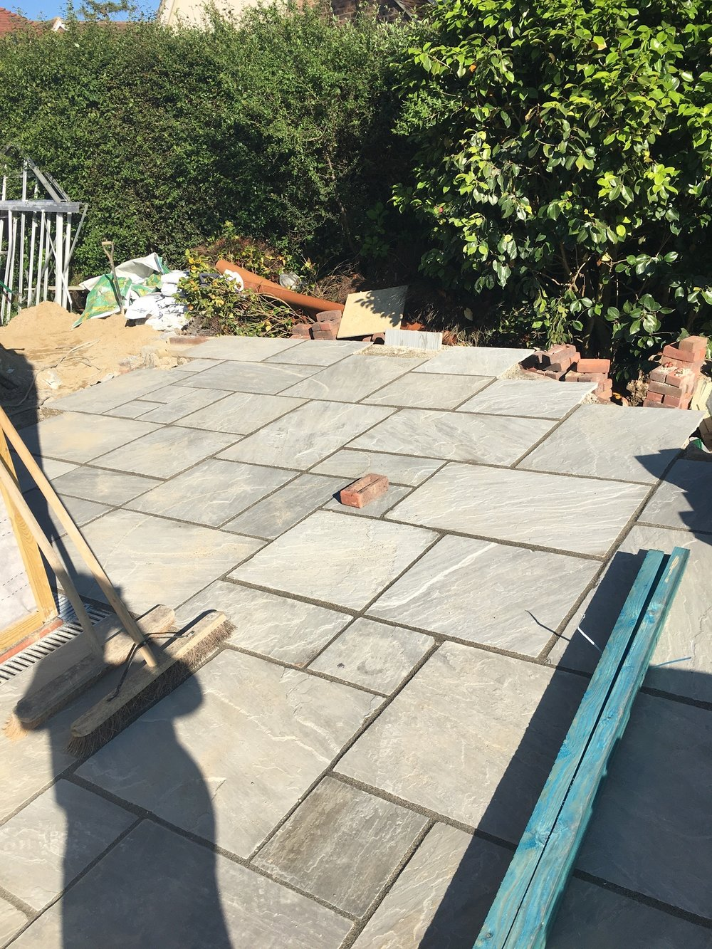 Patio goes down - grey Indian sandstone (spot my bump!).
