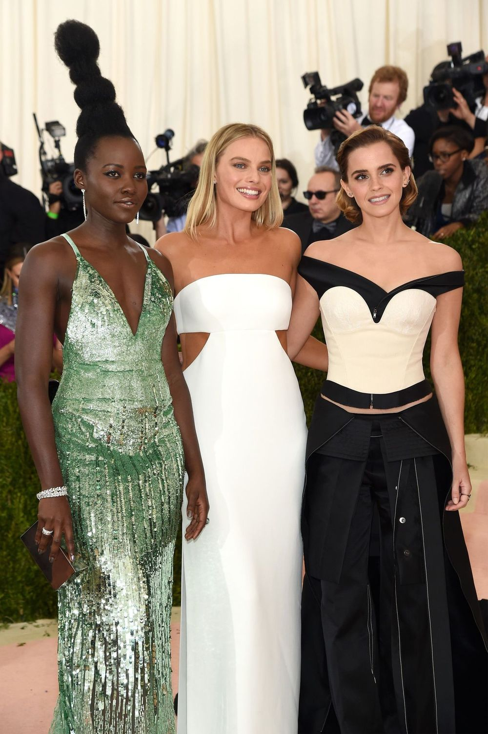 Lupita Nyong'o, Margot Robbie join Emma Watson in wearing Calvin Klein gowns designed to meet Livia Firth's Green Carpet challenge.