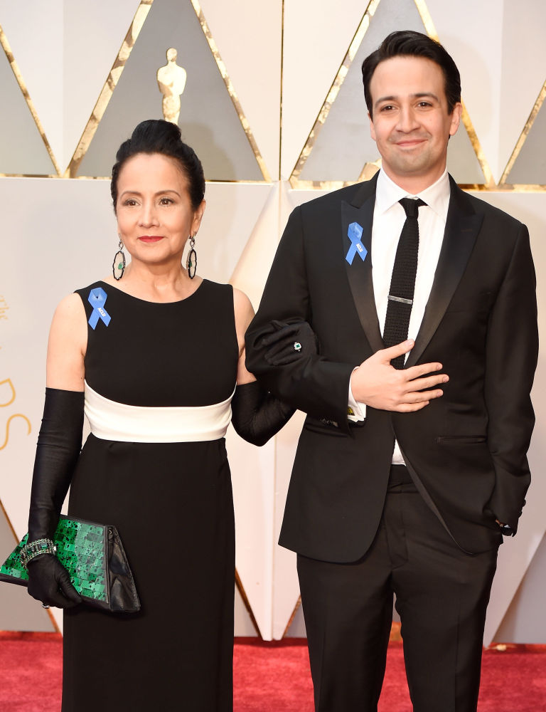 Dr. Luz Towns-Miranda (left) and Lin-Manuel Miranda. of 'Hamilton' wear their ACLU ribbons.