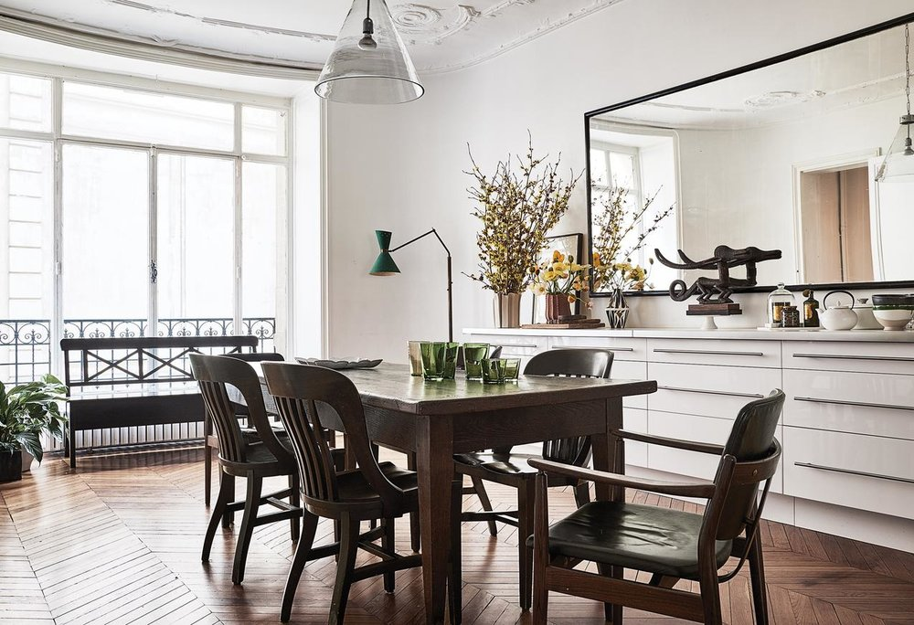 A French farmhouse table surrounded by 1930s bank chairs.PHOTO:MAGNUS MARDING FOR WSJ. MAGAZINE