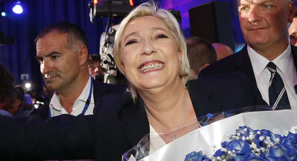 Marine Le Pen, far-right leader and candidate for the 2017 French presidential election, celebrates with supporters after exit poll results of the first round of the election were announced at her HQ in Henin-Beaumont on April 23. | AP Photo