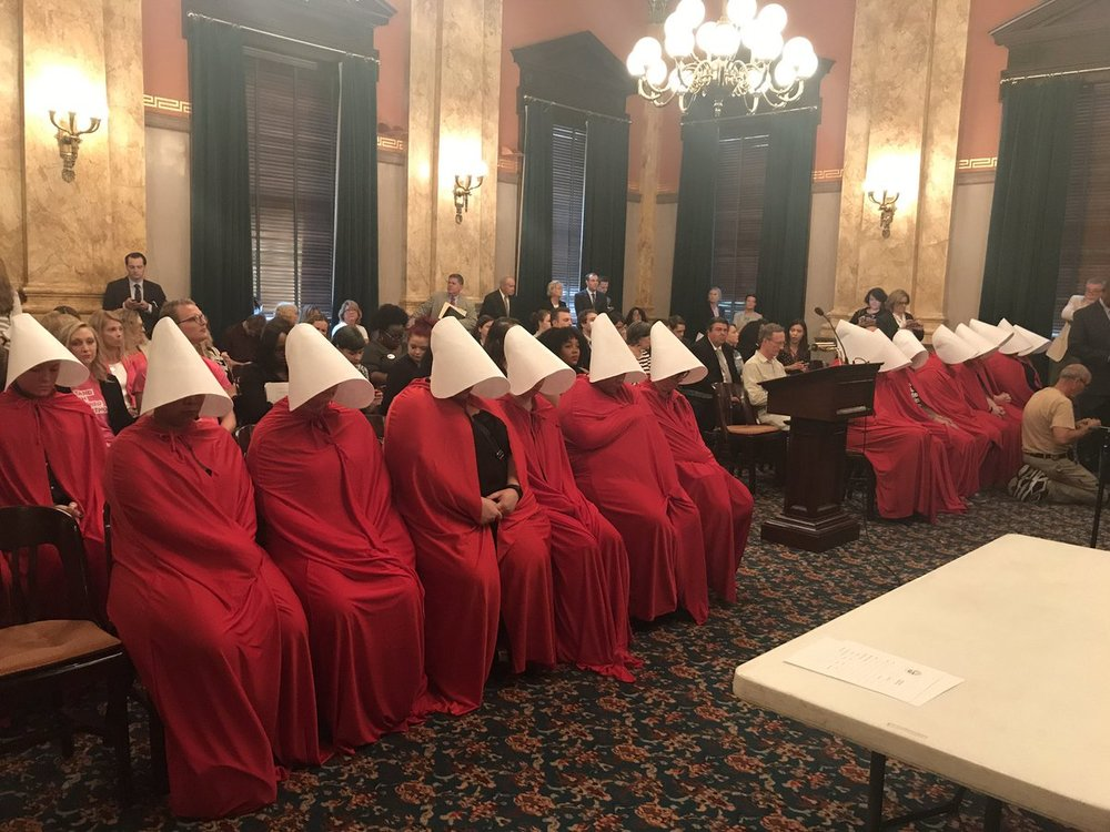 Ohio statehouse June 13, 2017 a activists channeling 'The Handmaid's Tale' protest new abortion restrictions.