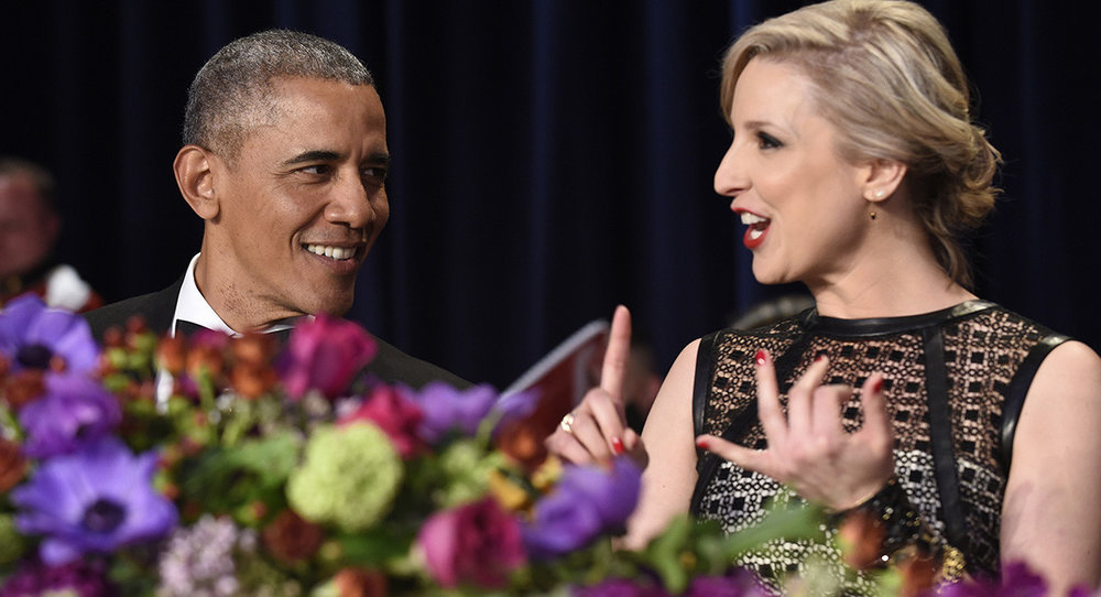 President Barack Obama talks with Carol Lee of The Wall Street Journal at the annual White House Correspondents' Association dinner in 2016. Lee previously served as president of the WHCA. | AP Photo