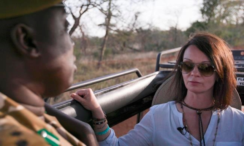 Taken on Feb. 25, 2016, Faye Cuevas of IFAW speaks with Capt. Kenneth Ocheing, a warden with the Kenya Wildlife Service (KWS), in Tsavo West National Park, Kenya. (Nina Schwendemann/IFAW via AP)