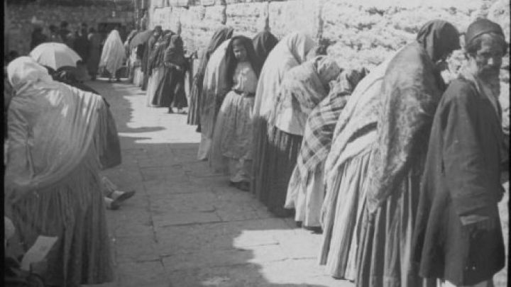 Women and men pray together at the Western Wall in Jerusalem, 1910. George Eastman House/Getty Images