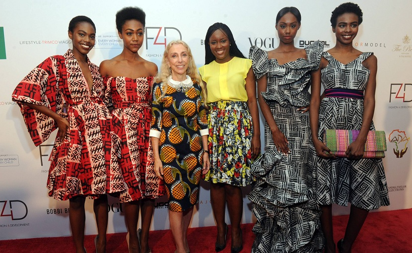 Franca Sozzani, center left, Editor-in-Chief Vogue Italia, and Madam Wokie designer, center right, attend the Fashion 4 Development First Ladies Luncheon and Fashion Show, Thursday, Sept. 26, 2013, in New York. The luncheon featured designs from Art of Heritage, which aims to preserve and protect Saudi heritage, and showcased high fashion from developing nations. (Photo by Diane Bondareff/Invision for Fashion 4 Development/AP Images)