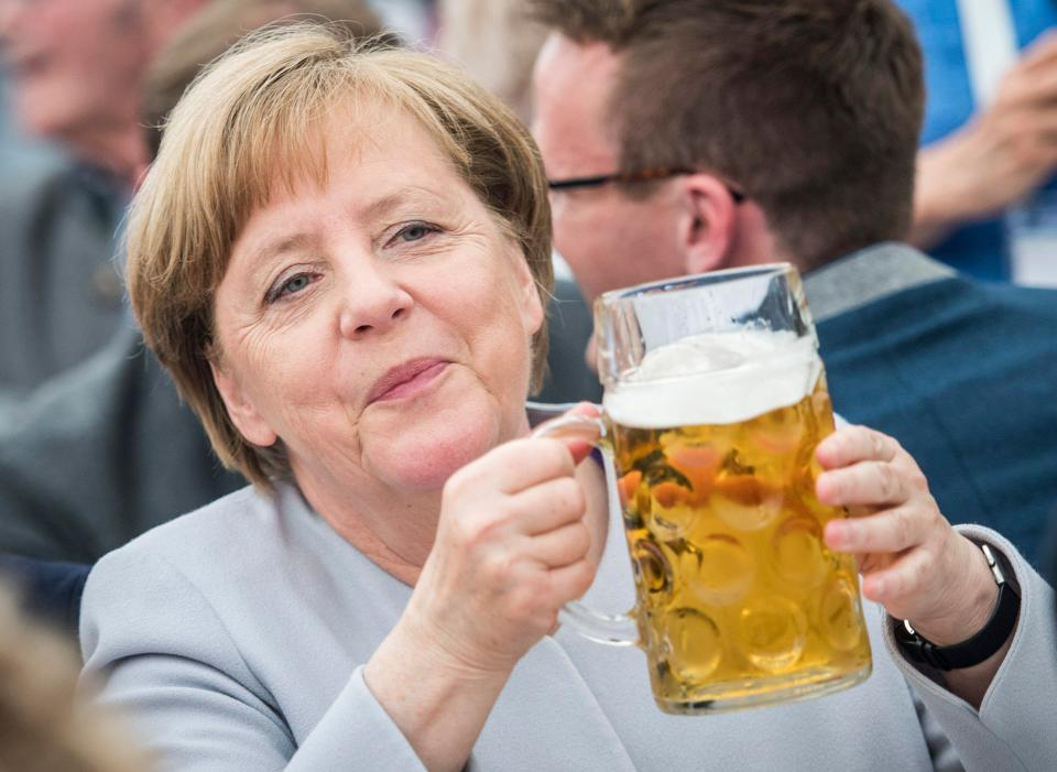 Angela Merkel wins re-election as chancellor of Germany, as opposition parties insure she will have a rough ride.
