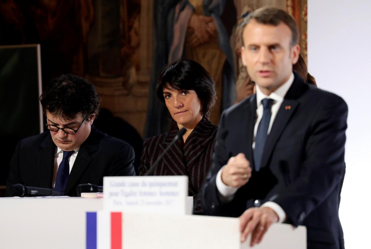 French President Emmanuel Macron (R) stands in front of Florence Foresti, French humorist and patron of association 'Women Safe', and French writer, activist and physicianPatrick Pelloux as he delivers a speech during the International Day for the Elimination of Violence Against Women, at the Elysee Palace in Paris, France, November 25, 2017. REUTERS/Ludovic Marin/Pool