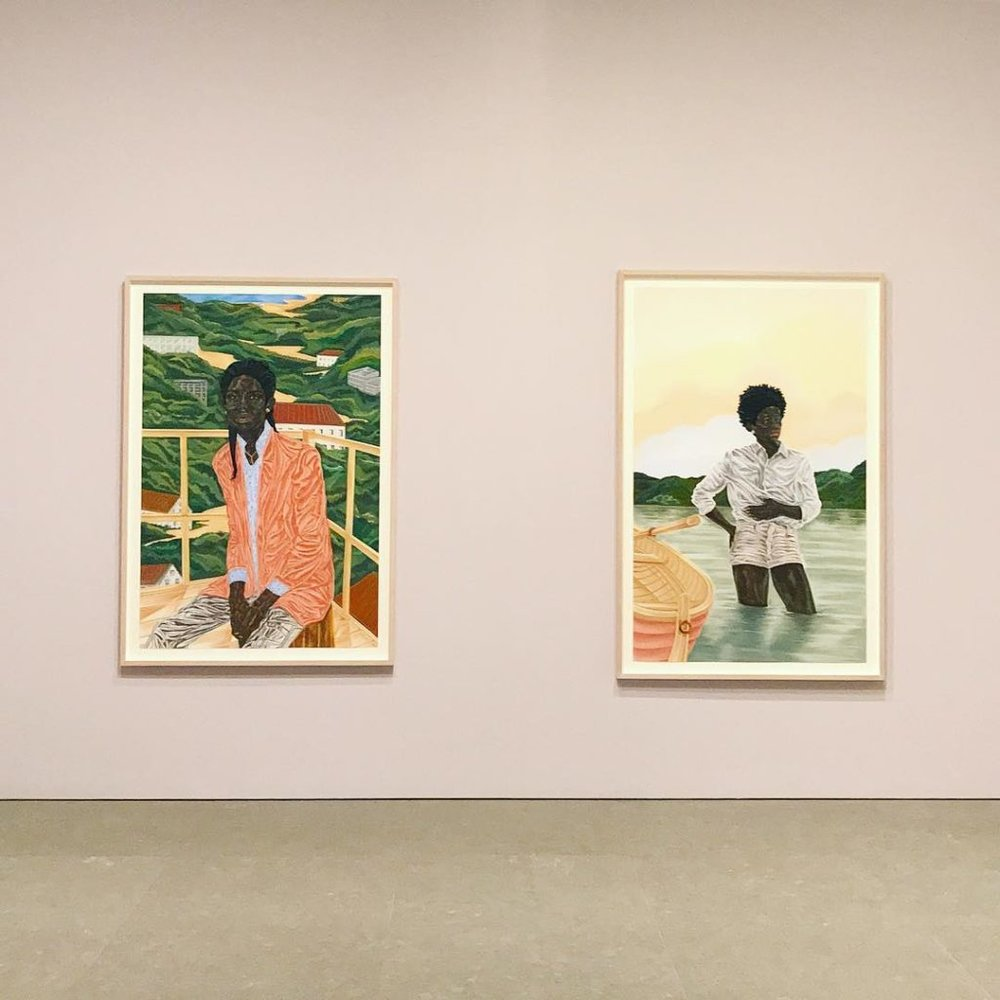 """Installation view, """"To Wander Determined"""" at the Whitney Museum. Left:  The Missionary  (2017), R:  By Her Design  (2017). ©Toyin Ojih Odutola. Courtesy of the artist and Jack Shainman Gallery, New York."""