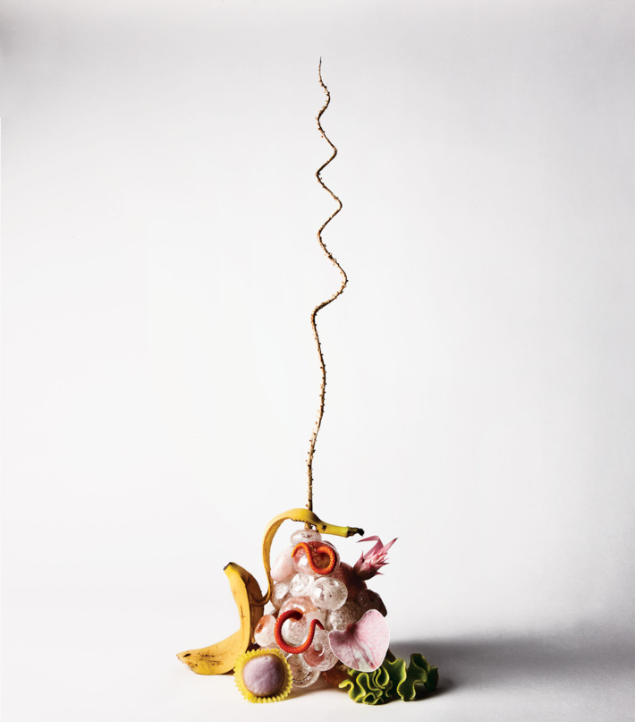 Coconut frond, anthurium, orchid, celosia, and bromeliad with a LBK Studio glass sculpture, $550 at  abchome.com .