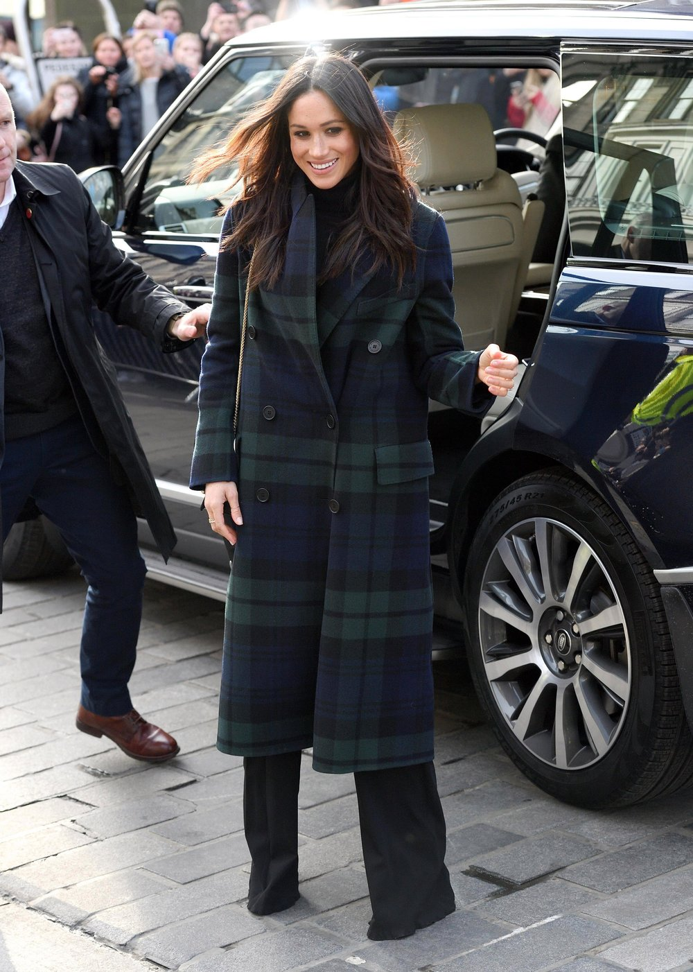 Meghan Markle wearing traditional Burberry tartan plaid on visit to Edinburgh Scotland.