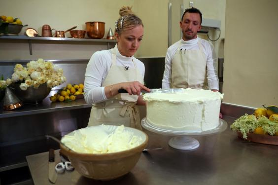 Ms Ptak is joined by Violet Bakery head baker Izaak Adams (WPA Pool/Getty Images)