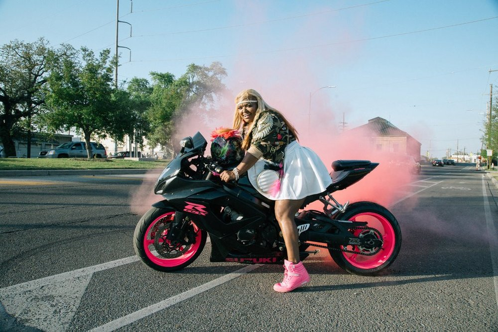 Nakosha Smith, also known as Coco, is a member of the Caramel Curves, the all-female African-American Motorcycle club based in New Orleans. Her tires have pink dye so the smoke appears pink when she does a burnout.CreditAkasha Rabut for The New York Times