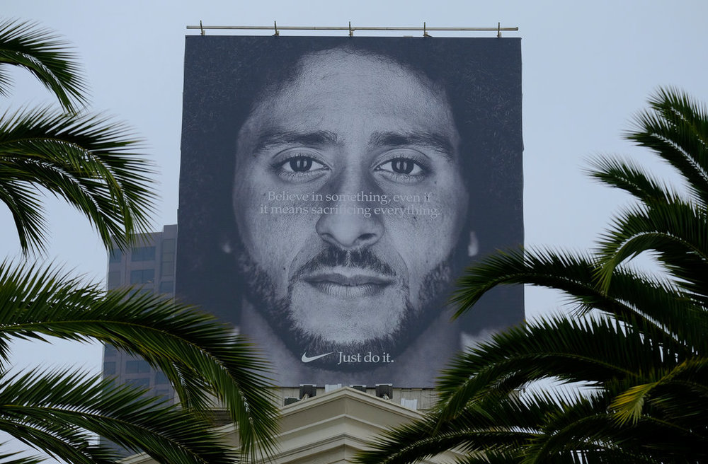 e808dc2910f81 A billboard on top of a Nike store features the former San Francisco 49ers  quarterback Colin