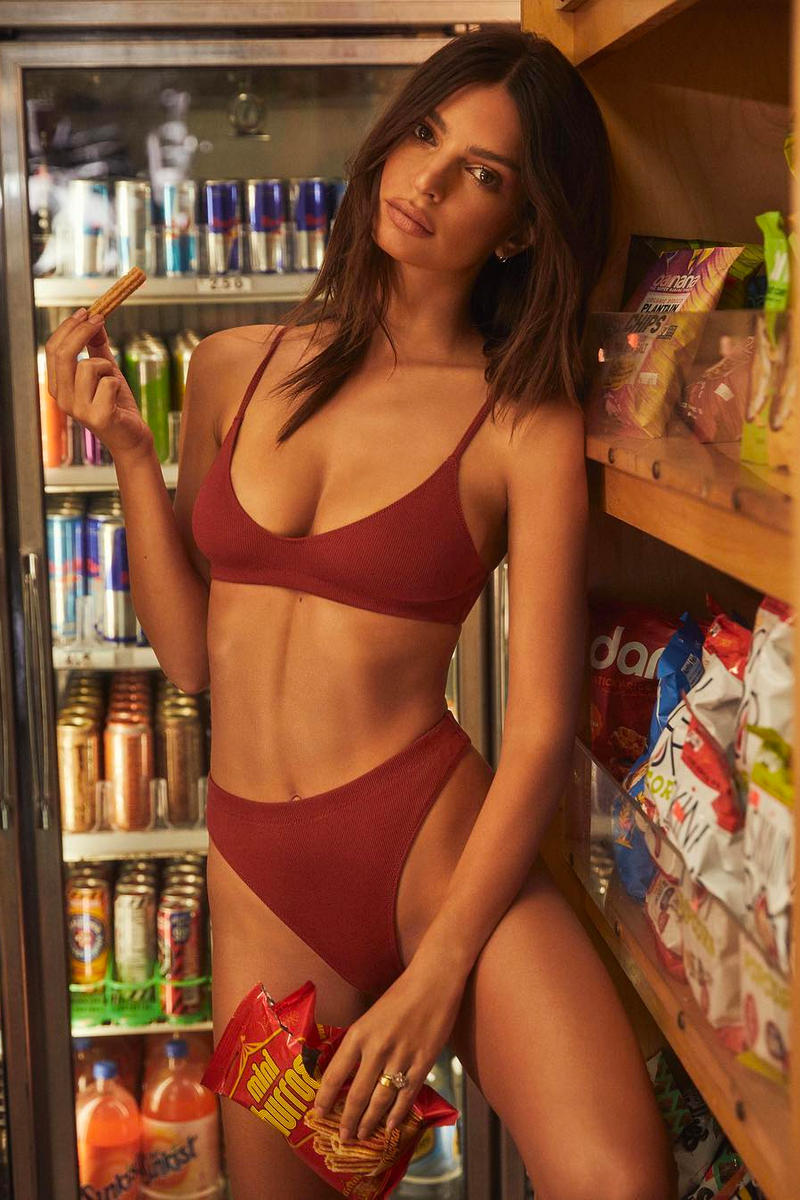 Emily Ratajkowski poses in a minimalist, burnt red bralette and a color-matching, high-waisted thong reminiscent of the  barely-there bikini styles offered by her swimwear line .