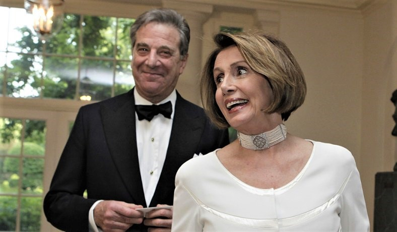 Nancy Pelosi and her husband Paul at the White House in 2011.
