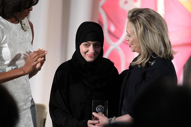 Political activist Samar Badawi is presented with an International Women of Courage Award by U.S. Secretary of State Hillary Clinton as first lady Michelle Obama looks on during a ceremony at the State Department March 8, 2012 in Washington, DC.  Alex Wong via Slate.com