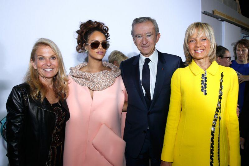 USA-France ambassador Jane D. Hartley, Rihanna, Bernard Arnault, and his wife Hélène Mercier at Christian Dior SS 2016 fashion show.