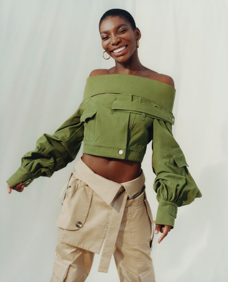 Michaela Coel wears Asai top and pants, and Georgiana Scott earrings. Photographed by Laura Coulson,  Vogue , February 2019. Styling by Charlotte Roberts.