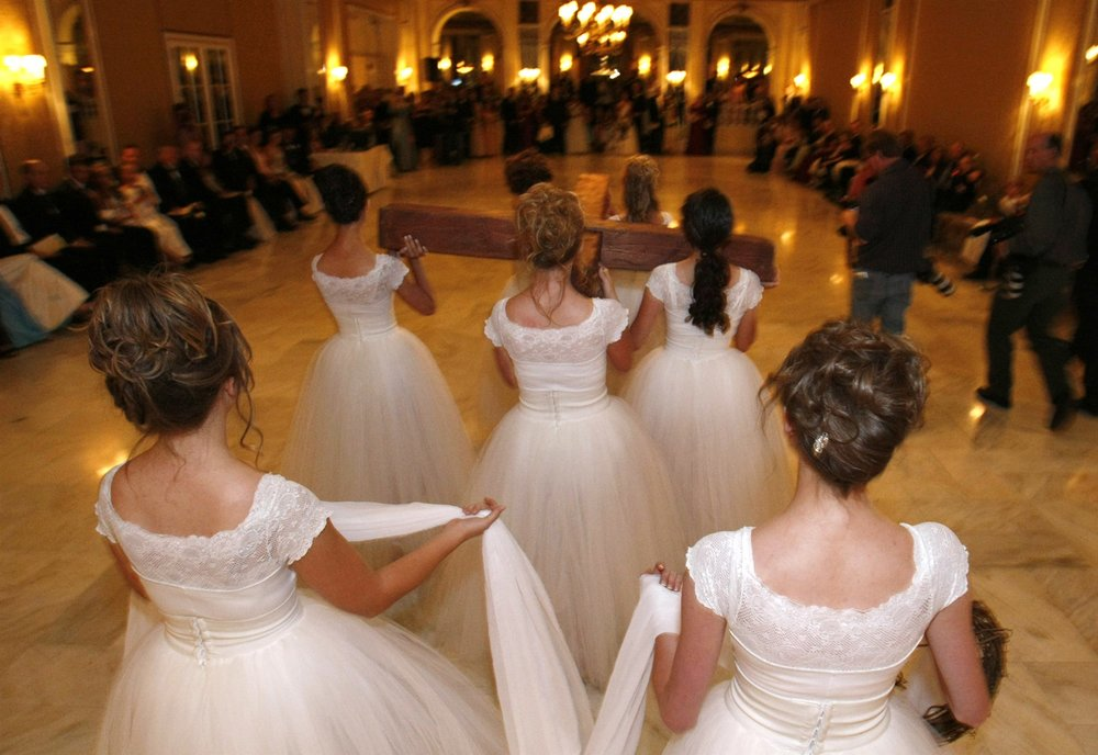 Ballet dancers of the Regal Daughters Ballet Company carry a cross into the ballroom at the annual Father-Daughter Purity Ball in Colorado Springs, Colorado on Sept. 14, 2007.Rick Wilking / Reuters file  via NBC News