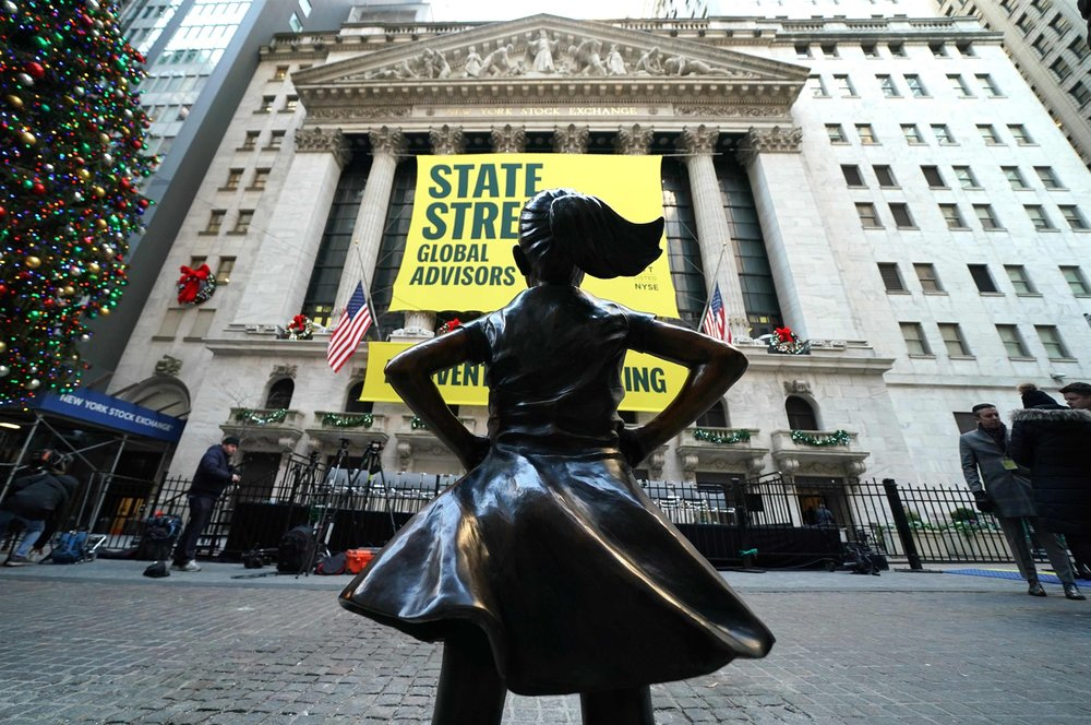 "The ""Fearless Girl"" statue is unveiled at her new home facing the New York Stock Exchange during an event on Dec. 10, 2018, held by the city of New York and State Street Global Advisors. Timothy A. Clary / AFP - Getty Images  via NBC News"