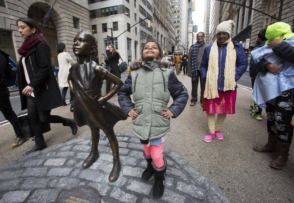"Shriya Gupta of Cherokee, N.C. strikes a pose with a statue titled ""Fearless Girl"