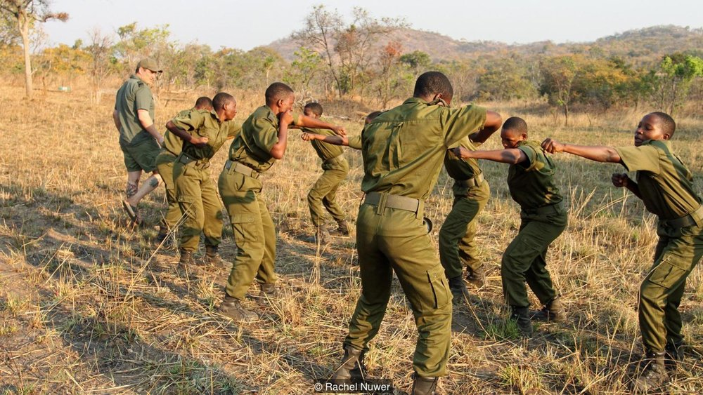 Damien Mander oversees combat training in Zimbabwe; the team he leads is thought to be the world's first all-women ranger unit protecting a nature reserve (Credit: Rachel Nuwer)