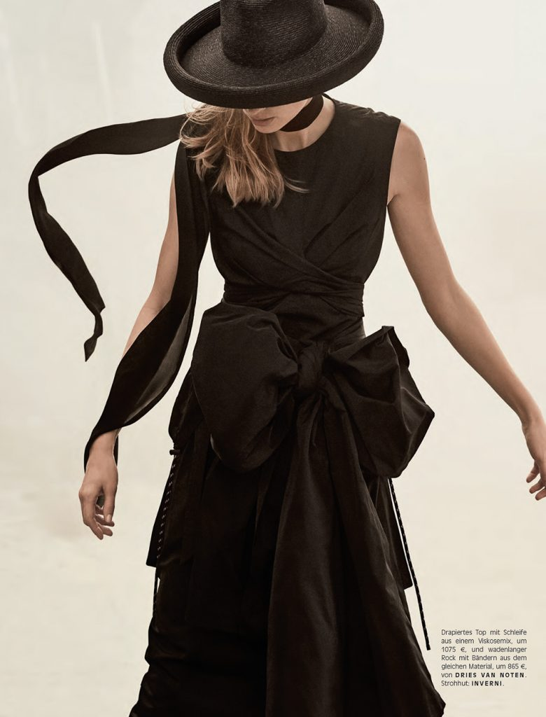 Julia Stegner wears black drama sobriety elegance with hats that match.