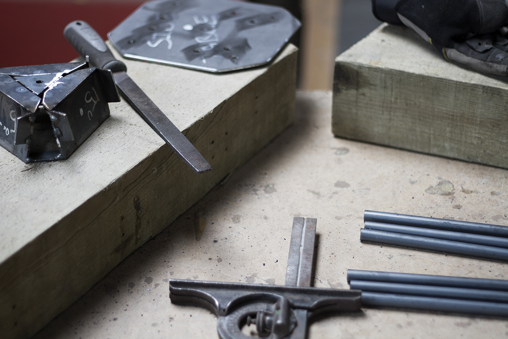 Tools and jigs used in the creation of steel hairpin legs at Cord Industries.