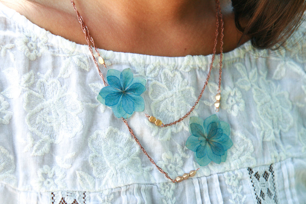 blue gold hydrangea expression pressed flower necklace with copper