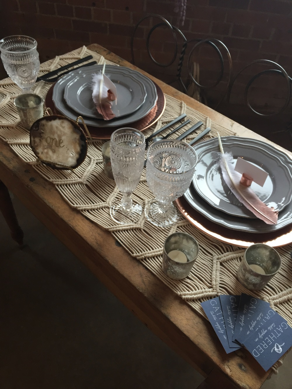 Featured: Copper Charger Plate, Grey Dinnerware, Copper Pipe Place Card Holder, Black Flatware, Agate Table Number, Clear Hobnail Vintage Goblet and Champagne Flute, and Marbled Votives