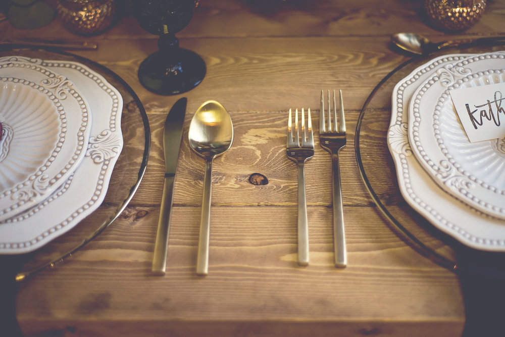 Get the look: Matte gold cutlery, glass gold rim charger plate, antique baroque dinner and salad plates