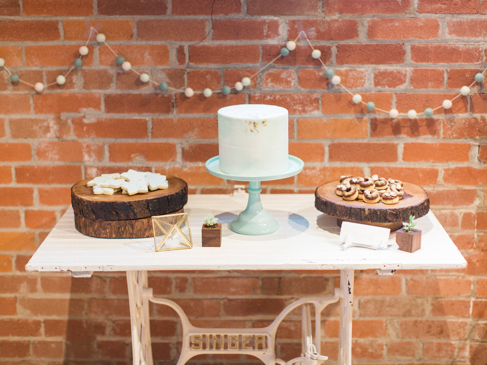 Get the look: wood slice centrepiece, mint cake stand, wood cake stand