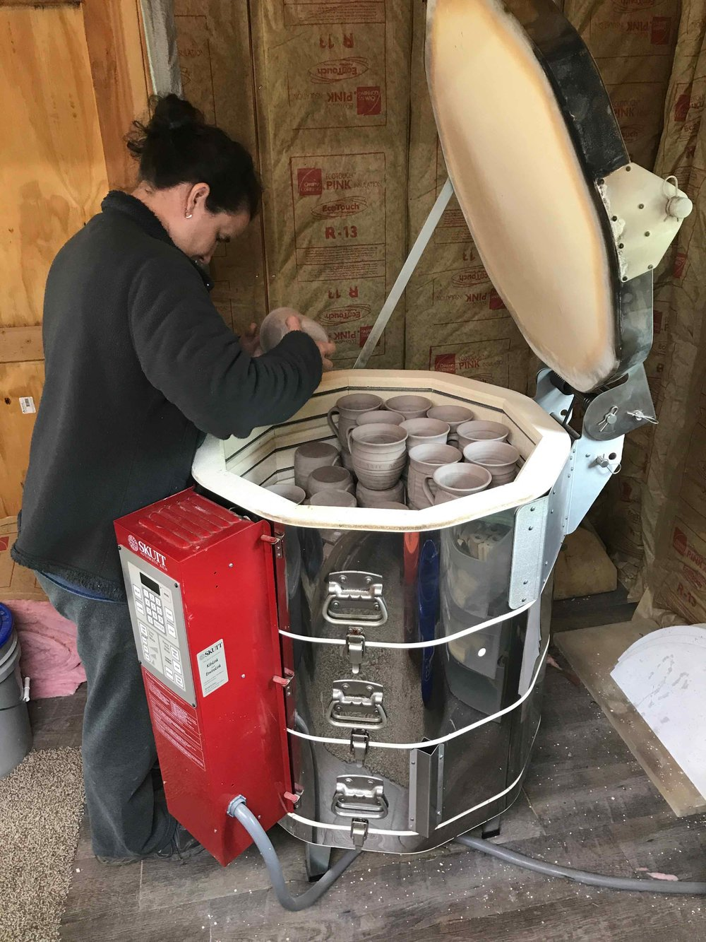 Dana is one of the greatest packing geniuses of all time.  She knows how to utilize every inch of space whether packing for a long family trip, or a kiln full of pots.