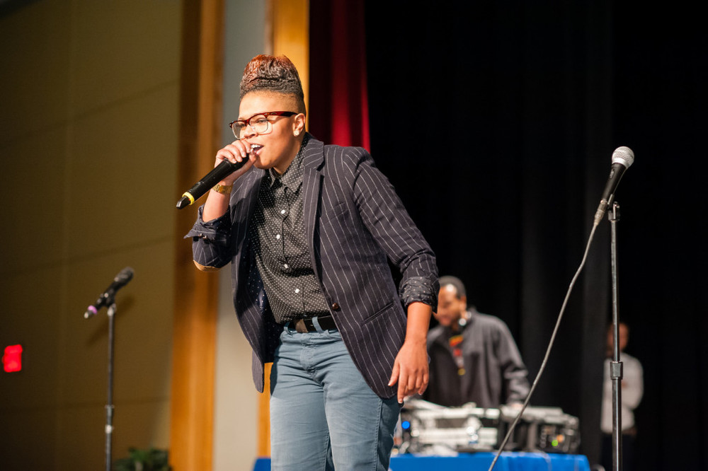 Charity Blackwell performing her poetry. (via AmericaScores.org)