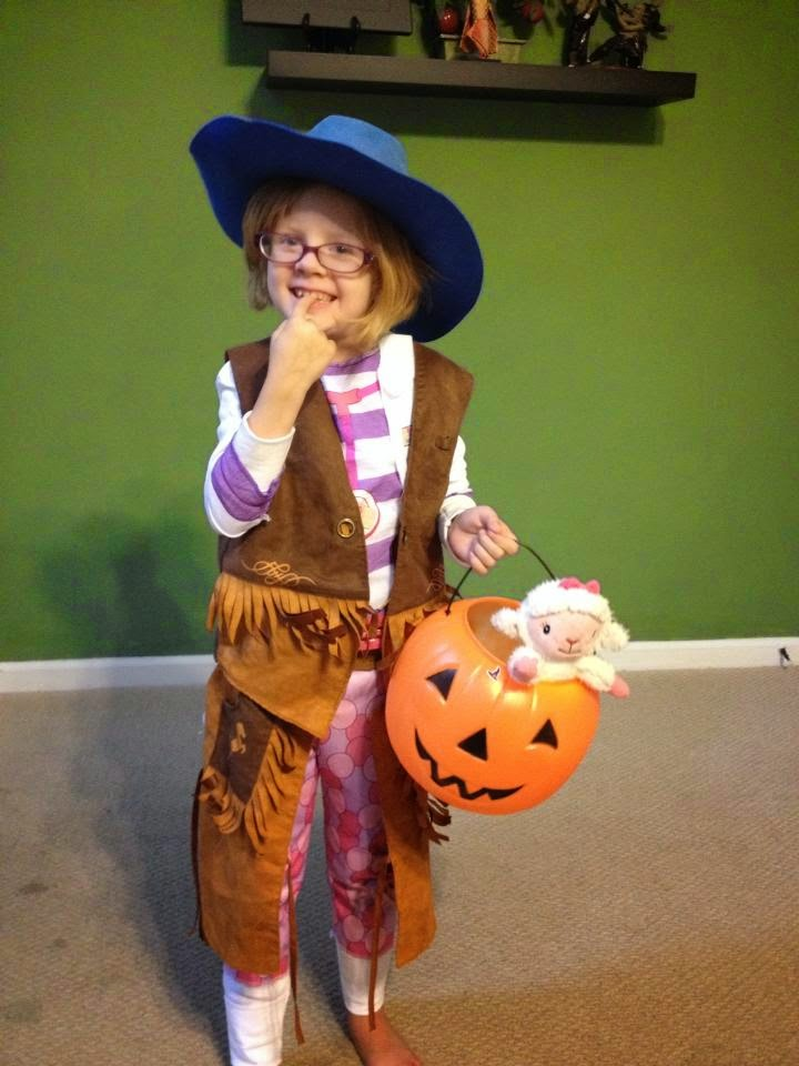 Most recent Halloween costume. She chose a Doc McStuffin's costume off the rack. Then she added accessories from home- result: Doc McStuffins dressed like a cowgirl.