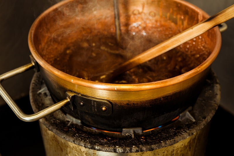 The fudge is cooked in a copper kettle to a precise temperature.