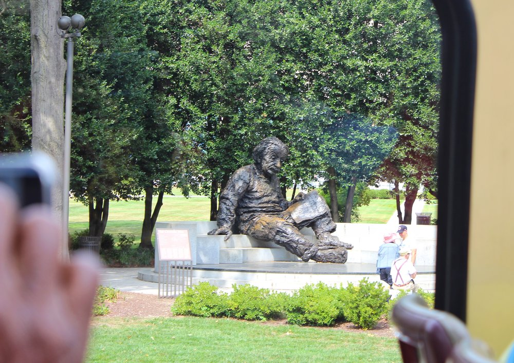 Einstein chilling with a book and no shoes #nerdgoals